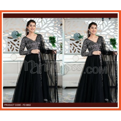 A FULL SEQUINS BLOUSE WITH NET LEHENGA