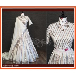 A  White Lehenga And Blouse Are Beautified With Sequins Embroidered work