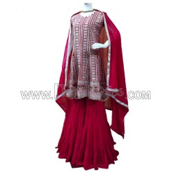 A SHARARA WITH HEAVY EMBROIDERY WORK TOP