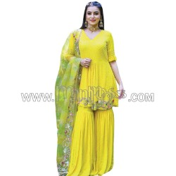 A YELLOW SHARARA WITH MOTI WORK TOP